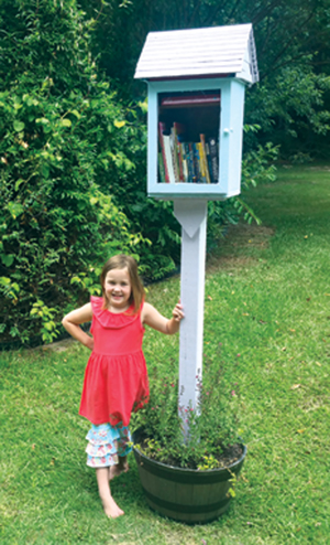 Local girl opens Little Free Library