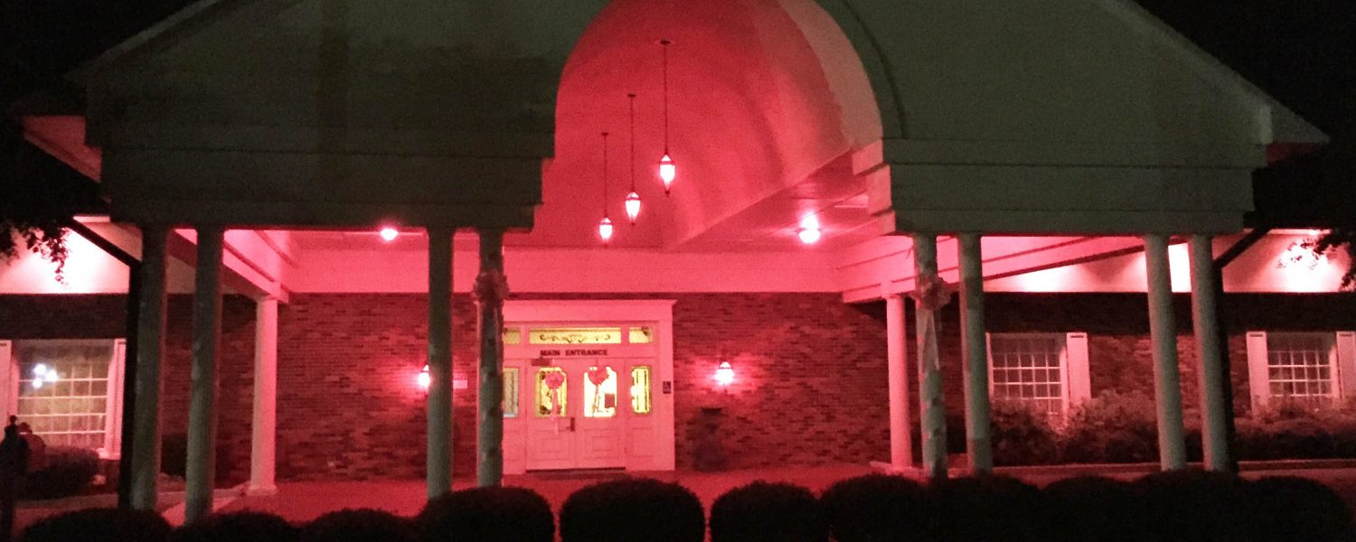 Attalla funeral home lights up for breast cancer awareness