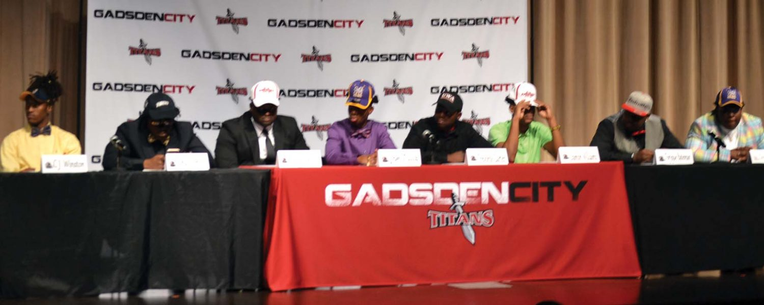Eight Titans sign college football scholarships