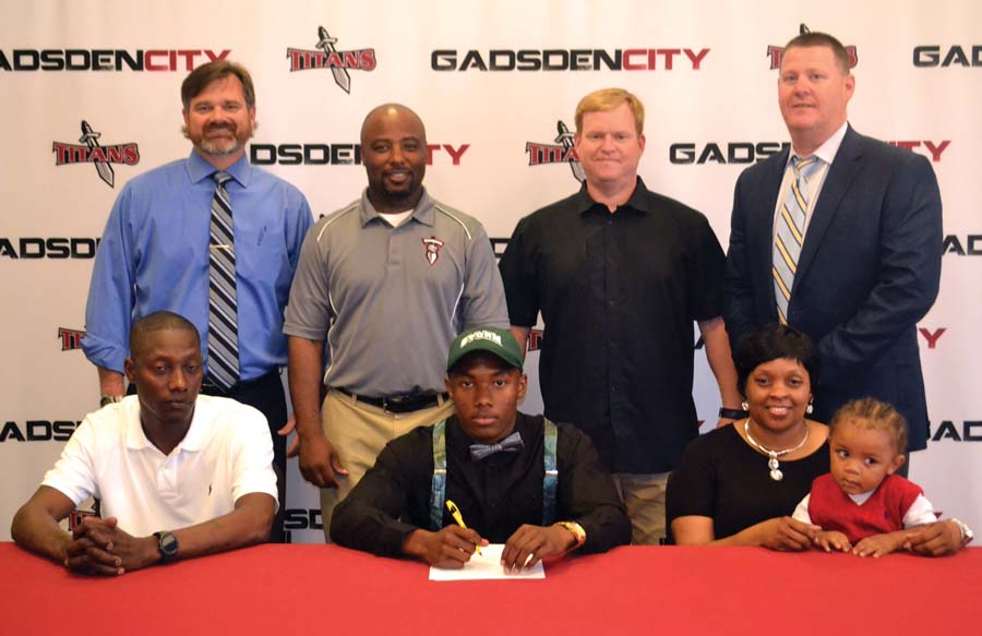 Titans' Isom signs football scholarship