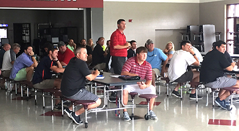 NEO symposium attracts over 100 local coaches