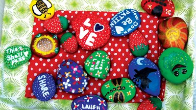 Locals spread kindness with painted rocks