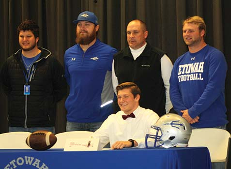 Etowah gridder signs football scholarship