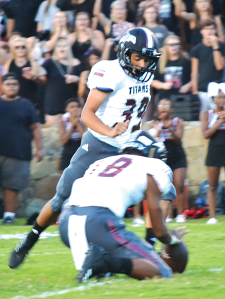 Titans rally past Florence for first win of season